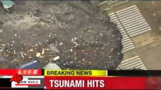 Raw Video -Tsunami Slams Northeast Japan