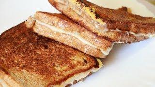 Смотреть онлайн Как делать вкусные гренки из хлеба с сыром и яйцом