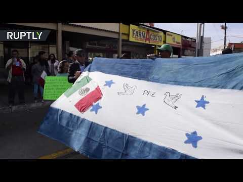 Migrant caravan tries to calm protesters' fears in Tijuana