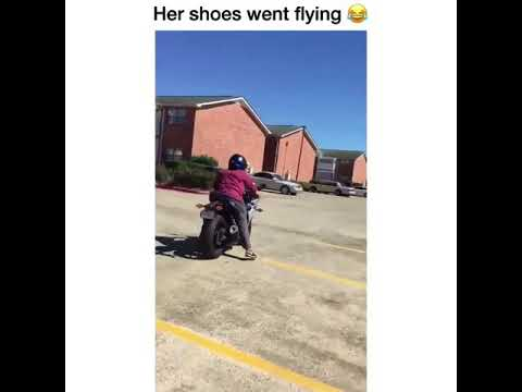 Girl's shoes go flying after falling of bike