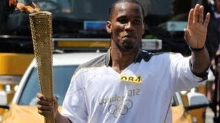 Ex Chelsea Star Drogba Carries Olympic Flame