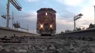 Railroad freight train runs over camera