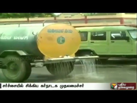 Controversy-over-water-sprinkled-along-the-road-taken-by-Karnataka-chief-minister
