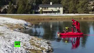 Red sleigh pushing the deer? Oregon firefighter performs rescue op on frozen lake