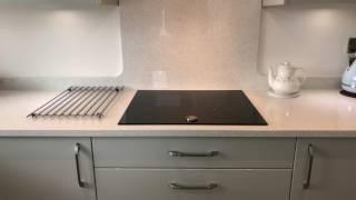 First Impressions Gloss Grey Slab Kitchen - Purple Kitchens