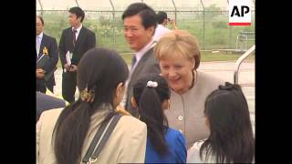 WRAP Brown, Merkel arrive at G8 summit ADDS Ban