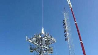 Crane lifting radio tower and FM antenna