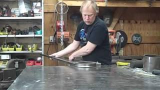 "Hand bending 1"" square 18 gauge steel tubing to a 4-1/2"" radius"
