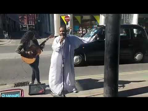 Woli Arole Performing Enugbe life on the streets of London; and no one answered him!
