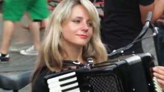 Beautiful Blonde Girl Playing Accordion in Rome