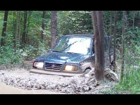 Suzuki Sidekick on muddy trails @ Southington Offroad, OH