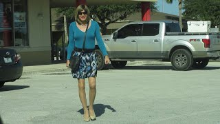 Crossdressing in a blue skirt and top