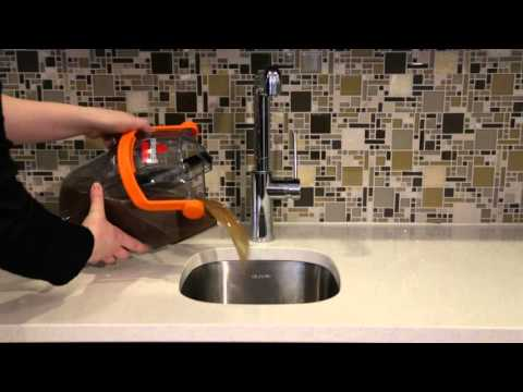 ProHeat 2X® Lift-Off® Upright Carpet Cleaner -Emptying Dirty Water Tank