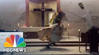 Priest Runs For Cover As Huge Beirut Blast Brings Stained Glass Windows Crashing Down | NBC News NOW