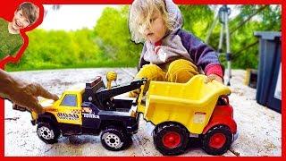 Tow Trucks Towing Dump Truck