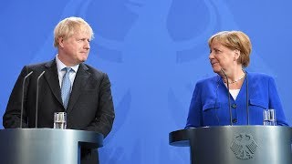 video: 'Wir schaffen das!': Boris Johnson draws eyeroll from Angela Merkel by echoing election slogan