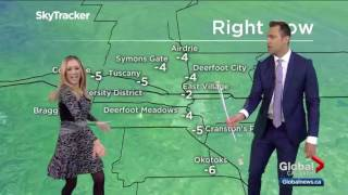 Reporter shows weatherman how to twirl a baton live on-air
