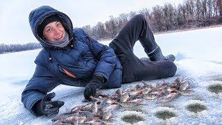 Ловля зимой красноперки на пруду
