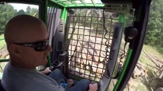 John Deere 437D knuckle boom log loader