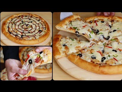 بيتزا المحلات بجبنة مطاطية وعجينة هشة وطرية بكل اسرارها
