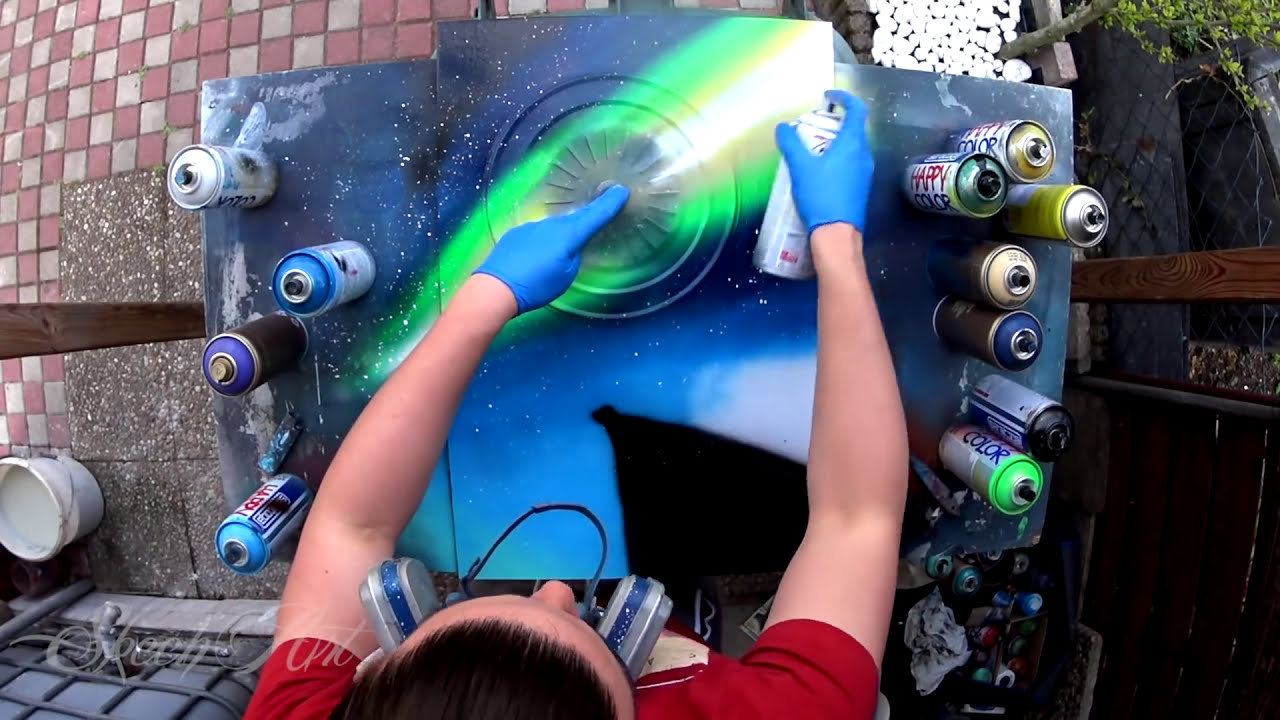 painting using spray cans world by skech art