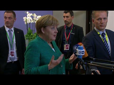 EU Summit: Angela Merkel and Emmanuel Macron react to migrants deal