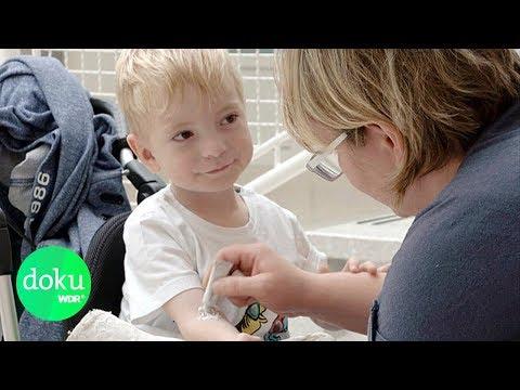 Die Würmer und ihre Symptome bei den Kindern des Bildes