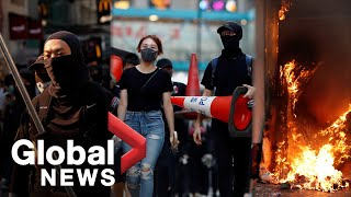 Hong Kong protesters vent anger on streets of Mong Kok, set fire to bank