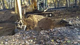 Prepping the Land: Basement Dug and Footings Poured