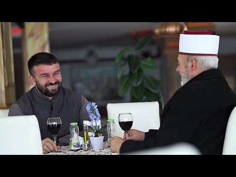 An imam and priest walk onto a football field...