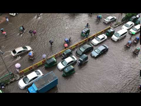 Downpour flooded Dhaka streets