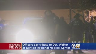 Police Officers Show Emotions Outside Denton Medical Center