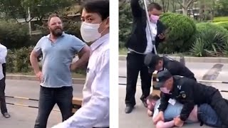 video: Watch: 'Drunk' Briton apprehended by Chinese police with pole for refusing to wear face mask