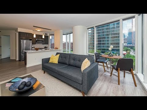 A spacious one-bedroom model at Streeterville's new Moment apartments