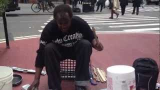 Homeless man plays drums out of garbage in New York City's Garment District