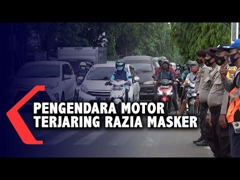 tidak memakai masker pengendara motor diberhentikan dan didenda