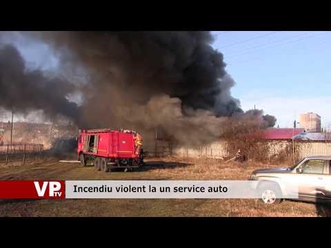 Incendiu violent la un service auto