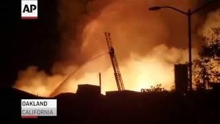 Fire destroys Oakland buildings, cause sought