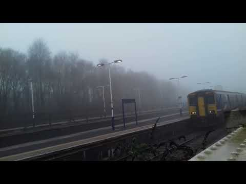 Northern Class 150 Sprinter 150214 departs a foggy Rochdale …
