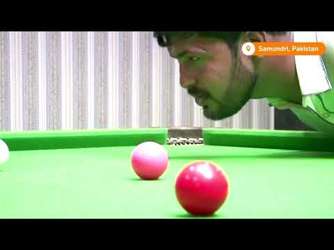Armless snooker player masters game