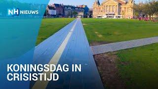 Zo leeg zag je Amsterdam nog nooit op Koningsdag