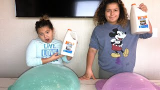 NEW YEARS SLIME VS NEW YEARS SLIME - MAKING GIANT SLIMES IN OUR HOTEL ROOM
