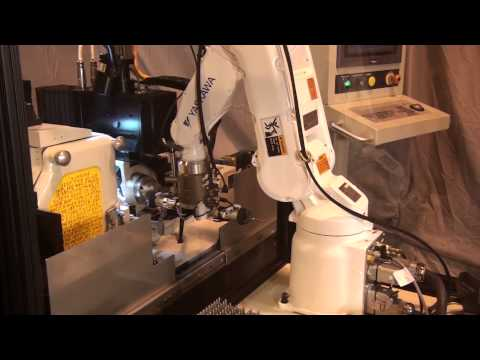 Application: Robot loading of a fluid dispensing nozzle with automatic gauging.