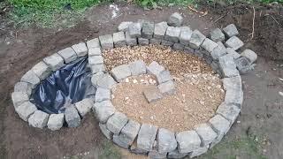 Kräuterspirale bauen