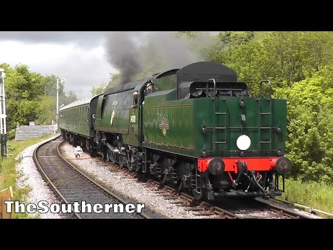 34070 'Manston' arrives and departs Corfe Castle on the Swan…