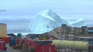 Giant iceberg threatens small Greenland settlement in view of the NATO Summit attendees