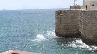 preview picture of video 'Teens, jumping into the Mediterranean Sea from a height of city walls of Acre'