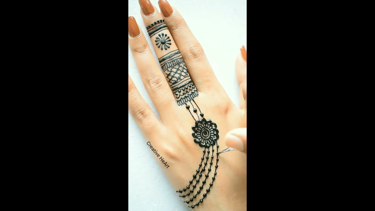 latest simple jewellery mehndi design for back hand by creative heart