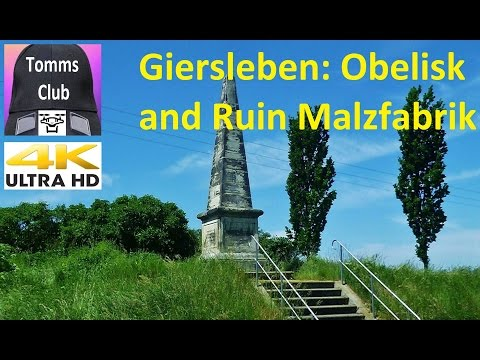 Obelisk and City Giersleben in Germany Saxony-Anhalt Ruin Malzfabrik from the air in 4K UHD