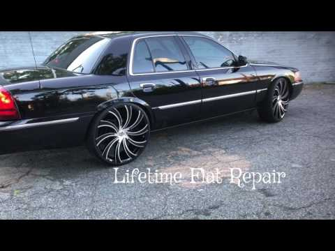 "2005 Mercury Grand Marquis on 24"" Massiv 922 Swerva wheels with 275/25-24 Lexani tires."
